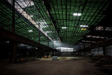 Large industrial hall with low light