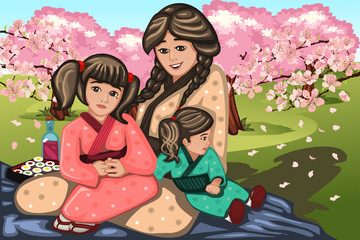 Japanese woman and her children during Cherry Blossom
