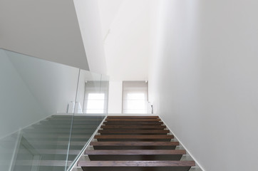 wooden staircase and glass balustrade