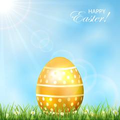 Golden Easter egg in a grass