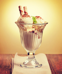 Ice cream in the glass on the table. Vintage retro hipster style