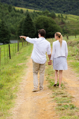 young couple walking in country road