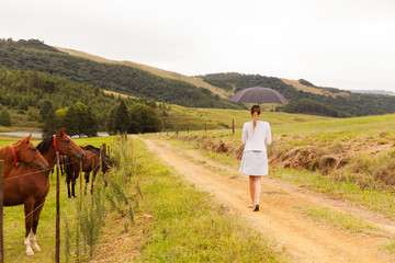 young woman walking on farm road