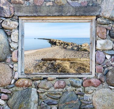 Coastal landscape seen through old broken window
