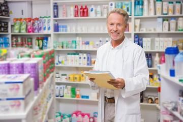Senior pharmacist holding documents