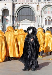 Black Mask and Golden costumes for the Carnival in Venice Italy