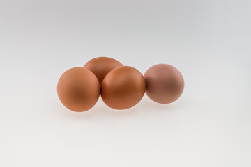 Four eggs. Isolated on white background