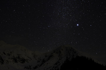 Milky way in winter Carpathian Mountains landscape