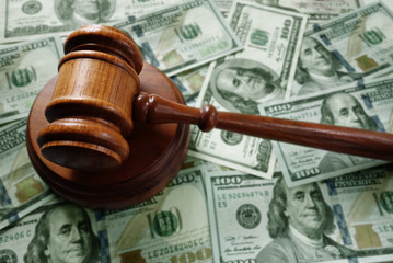 Judge gavel on cash
