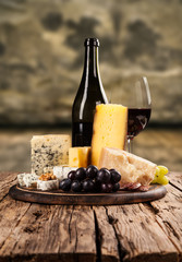Various kind of cheese with wine