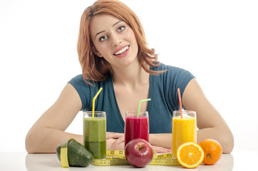 Happy woman having a table full of organic food,juices,smoothie