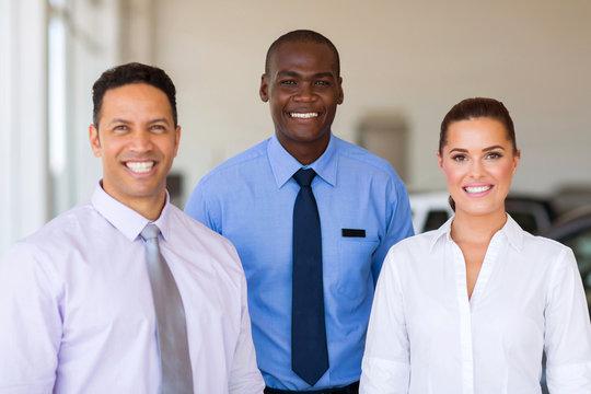 group of car dealership staff