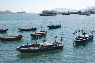 Wooden fishing boats on water in Hong Kong