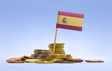 Flag of Spain in a stack of coins.(series)