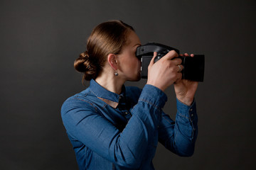 Photographer woman holding camera and taking pictures