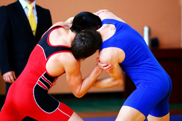 Greco-Roman wrestlers in competition