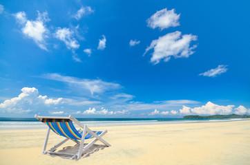 Chair under blue cloudy sky at koh Payam , Ranong , Thailand