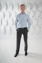 Business man full lenght in modern urban office