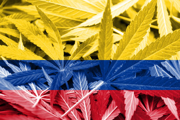 Colombia Flag on cannabis background.