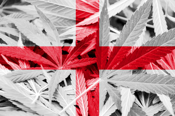 England Flag on cannabis background. Drug policy.