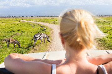 Woman on african wildlife safari.