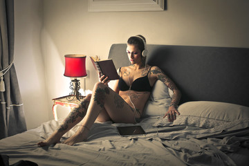 Tattooed girl reading