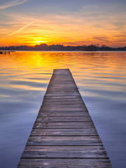 Wall Mural - Majestic Sunset over Wooden Jetty in Groningen, Netherlands