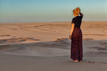 Woman on the top of dune