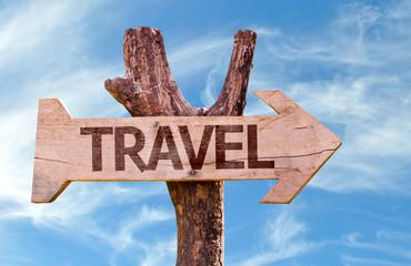 Travel wooden sign with sky background
