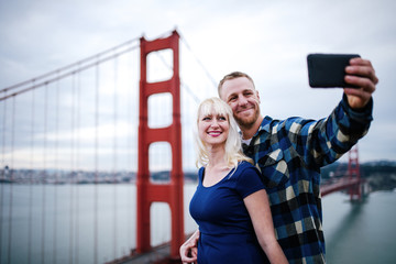 couple selfie by golden gate bridge with film grain filter