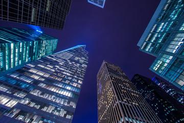 Foto op Canvas Aan het plafond Famous skyscrapers of New York at night