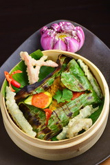 Red snapper fish fillet wraped in banana leaf  with tempura