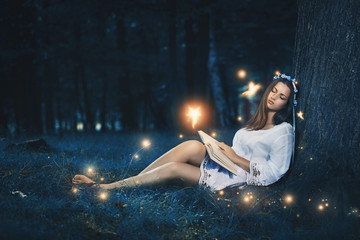 Beautiful woman sleeping among fairies