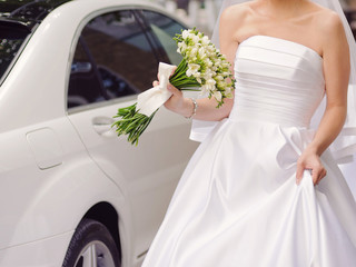 Bride with Bouquet at Car