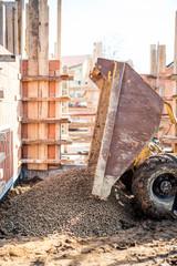 Dumper truck unloading construction gravel, granite, stones