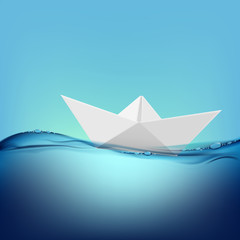 paper boat floating on the water surface
