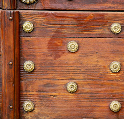 abstract  rusty brass brown knocker door crenna gallarate  italy