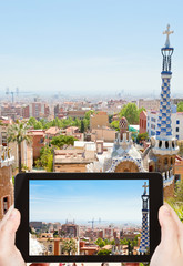 tourist taking photo of Barcelona cityscape