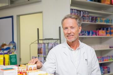 Senior pharmacist standing and posing