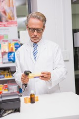 Senior pharmacist using the computer
