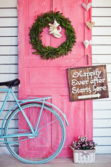 Valentine wreath and sign board on wooden vintage pink door