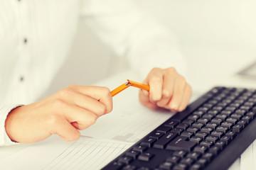 woman breaking pencil