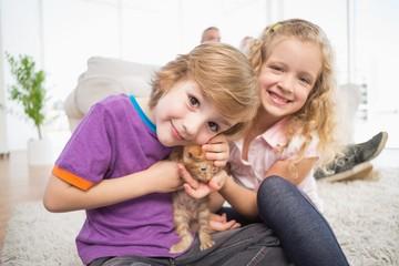 Cute siblings with kitten