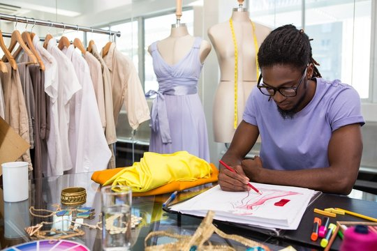 Attractive african american male fashion designer sketching