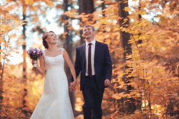 bride and groom in autumn park Love Life