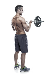 Muscular bodybuilder guy doing exercises with big dumbbell over