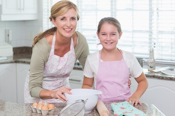 Mother and daughter making cake together