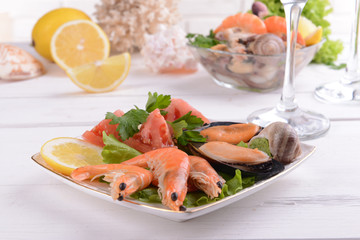 Tasty seafood on plate on table close-up