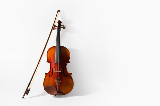 Violin and bow on white background