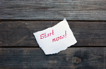 start now written on piece of paper